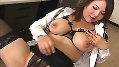 Horny office MILF pulls out a sex toy from her drawer and toys her wet pussy