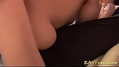 Pretty Asian gives cock massage with her large boobies
